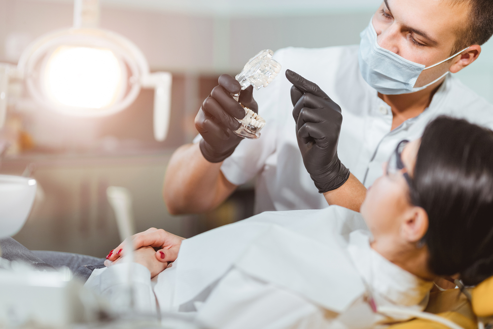 Dentist attending to patient in chair